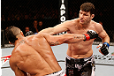 SAO PAULO, BRAZIL - JANUARY 19:  (R-L) Michael Bisping punches Vitor Belfort in their middleweight fight at the UFC on FX event on January 19, 2013 at Ibirapuera Gymnasium in Sao Paulo, Brazil. (Photo by Josh Hedges/Zuffa LLC/Zuffa LLC via Getty Images)