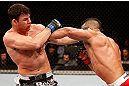 SAO PAULO, BRAZIL - JANUARY 19:  (R-L) Vitor Belfort punches Michael Bisping in their middleweight fight at the UFC on FX event on January 19, 2013 at Ibirapuera Gymnasium in Sao Paulo, Brazil. (Photo by Josh Hedges/Zuffa LLC/Zuffa LLC via Getty Images)