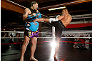 CHICAGO, IL - JANUARY 23:  Anthony Pettis (R) conducts an open workout session for media on January 23, 2013 at UFC Gym in Chicago, Illinois. (Photo by Josh Hedges/Zuffa LLC/Zuffa LLC via Getty Images)