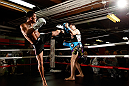 CHICAGO, IL - JANUARY 23:  Anthony Pettis (L) conducts an open workout session for media on January 23, 2013 at UFC Gym in Chicago, Illinois. (Photo by Josh Hedges/Zuffa LLC/Zuffa LLC via Getty Images)