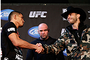 "CHICAGO, IL - JANUARY 24:  (L-R) Opponents Anthony Pettis and Donald ""Cowboy"" Cerrone shake hands during the UFC on FOX press conference on January 24, 2013 at the United Center in Chicago, Illinois. (Photo by Josh Hedges/Zuffa LLC/Zuffa LLC via Getty Images)"