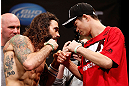CHICAGO, IL - JANUARY 25:  (L-R) Opponents Clay Guida and Hatsu Hioki face off during the UFC on FOX weigh-in on January 25, 2013 at the Chicago Theatre in Chicago, Illinois. (Photo by Josh Hedges/Zuffa LLC/Zuffa LLC via Getty Images)