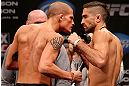 CHICAGO, IL - JANUARY 25:  (L-R) Opponents Erik Koch and Ricardo Lamas face off during the UFC on FOX weigh-in on January 25, 2013 at the Chicago Theatre in Chicago, Illinois. (Photo by Josh Hedges/Zuffa LLC/Zuffa LLC via Getty Images)