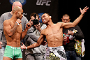 CHICAGO, IL - JANUARY 25:  (L-R) Opponents Demetrious Johnson and John Dodson face off during the UFC on FOX weigh-in on January 25, 2013 at the Chicago Theatre in Chicago, Illinois. (Photo by Josh Hedges/Zuffa LLC/Zuffa LLC via Getty Images)