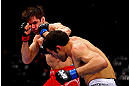 CHICAGO, IL - JANUARY 26:  David Mitchell (Front) punches Simeon Thoresen (Back) during their Welterweight Bout part of Facebook Prelims at United Center on January 26, 2013 in Chicago, Illinois.  (Photo by Al Bello/Zuffa LLC/Zuffa LLC Via Getty Images)