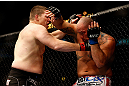 CHICAGO, IL - JANUARY 26:  Shawn Jordan (R) gets punched by Mike Russow (L) during their Heavyweight Bout part of UFC on FOX at United Center on January 26, 2013 in Chicago, Illinois.  (Photo by Josh Hedges/Zuffa LLC/Zuffa LLC Via Getty Images)