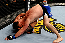CHICAGO, IL - JANUARY 26:  Ryan Bader (L) chokes Vladimir Matyushenko (R) during their Light Heavyweight Bout part of UFC on FOX at United Center on January 26, 2013 in Chicago, Illinois.  (Photo by Al Bello/Zuffa LLC/Zuffa LLC Via Getty Images)