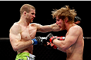 CHICAGO, IL - JANUARY 26:  Pascal Krauss (L) punches Mike Stumpf (R) during their Welterweight Bout part of UFC on FOX at United Center on January 26, 2013 in Chicago, Illinois.  (Photo by Josh Hedges/Zuffa LLC/Zuffa LLC Via Getty Images)