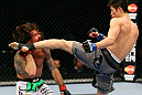 CHICAGO, IL - JANUARY 26:  Hatsu Hioki (R) kicks Clay Guida (L) during their Featherweight Bout part of UFC on FOX at United Center on January 26, 2013 in Chicago, Illinois.  (Photo by Al Bello/Zuffa LLC/Zuffa LLC Via Getty Images)
