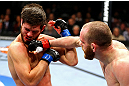 CHICAGO, IL - JANUARY 26:  TJ Grant (R) punches Matt Wiman (L) during their Lightweight Bout part of UFC on FOX at United Center on January 26, 2013 in Chicago, Illinois.  (Photo by Al Bello/Zuffa LLC/Zuffa LLC Via Getty Images)