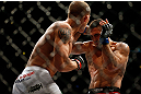 CHICAGO, IL - JANUARY 26:  Ricardo Lamas (R) fights Erik Koch (L) during their Featherweight Bout part of UFC on FOX at United Center on January 26, 2013 in Chicago, Illinois.  (Photo by Josh Hedges/Zuffa LLC/Zuffa LLC Via Getty Images)