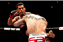 CHICAGO, IL - JANUARY 26:  Anthony Pettis (L) kicks Donald Cerrone (R) during their Lightweight Bout part of UFC on FOX at United Center on January 26, 2013 in Chicago, Illinois.  (Photo by Josh Hedges/Zuffa LLC/Zuffa LLC Via Getty Images)