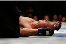 CHICAGO, IL - JANUARY 26:  Donald Cerrone lays on the ground after losing to Anthony Pettis during their Lightweight Bout part of UFC on FOX at United Center on January 26, 2013 in Chicago, Illinois.  (Photo by Josh Hedges/Zuffa LLC/Zuffa LLC Via Getty Images)