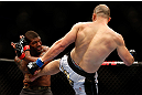 CHICAGO, IL - JANUARY 26:  Glover Teixeira (R) kicks Rampage Jackson (L) during their Light Heavyweight Bout part of UFC on FOX at United Center on January 26, 2013 in Chicago, Illinois.  (Photo by Josh Hedges/Zuffa LLC/Zuffa LLC Via Getty Images)