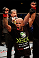 CHICAGO, IL - JANUARY 26:  Demetrious Johnson celebrates defeating John Dodson during thier Flyweight Championship Bout part of UFC on FOX at United Center on January 26, 2013 in Chicago, Illinois.  (Photo by Josh Hedges/Zuffa LLC/Zuffa LLC Via Getty Images)