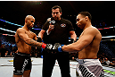 CHICAGO, IL - JANUARY 26:  John Dodson (R) taps gloves with Demetrious Johnson (L) during thier Flyweight Championship Bout part of UFC on FOX at United Center on January 26, 2013 in Chicago, Illinois.  (Photo by Josh Hedges/Zuffa LLC/Zuffa LLC Via Getty Images)