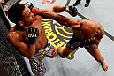 CHICAGO, IL - JANUARY 26:  Demetrious Johnson (R) punches John Dodson (L) during thier Flyweight Championship Bout part of UFC on FOX at United Center on January 26, 2013 in Chicago, Illinois.  (Photo by Josh Hedges/Zuffa LLC/Zuffa LLC Via Getty Images)