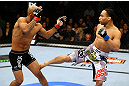 CHICAGO, IL - JANUARY 26:  John Dodson (R) kicks Demetrious Johnson (L) during thier Flyweight Championship Bout part of UFC on FOX at United Center on January 26, 2013 in Chicago, Illinois.  (Photo by Al Bello/Zuffa LLC/Zuffa LLC Via Getty Images)