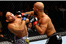 CHICAGO, IL - JANUARY 26:  John Dodson (L) fights Demetrious Johnson (R) during thier Flyweight Championship Bout part of UFC on FOX at United Center on January 26, 2013 in Chicago, Illinois.  (Photo by Al Bello/Zuffa LLC/Zuffa LLC Via Getty Images)