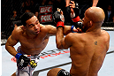 CHICAGO, IL - JANUARY 26:  John Dodson (L) punches Demetrious Johnson (R) during thier Flyweight Championship Bout part of UFC on FOX at United Center on January 26, 2013 in Chicago, Illinois.  (Photo by Al Bello/Zuffa LLC/Zuffa LLC Via Getty Images)