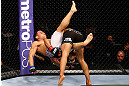 CHICAGO, IL - JANUARY 26:  John Dodson (L) gets dumped by Demetrious Johnson (R) during thier Flyweight Championship Bout part of UFC on FOX at United Center on January 26, 2013 in Chicago, Illinois.  (Photo by Al Bello/Zuffa LLC/Zuffa LLC Via Getty Images)