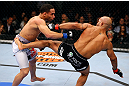 CHICAGO, IL - JANUARY 26:  Demetrious Johnson (R) kicks John Dodson (L) during thier Flyweight Championship Bout part of UFC on FOX at United Center on January 26, 2013 in Chicago, Illinois.  (Photo by Al Bello/Zuffa LLC/Zuffa LLC Via Getty Images)