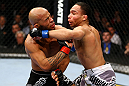 CHICAGO, IL - JANUARY 26:  John Dodson (R) punches Demetrious Johnson (L) during thier Flyweight Championship Bout part of UFC on FOX at United Center on January 26, 2013 in Chicago, Illinois.  (Photo by Al Bello/Zuffa LLC/Zuffa LLC Via Getty Images)