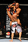 CHICAGO, IL - JANUARY 26:  Demetrious Johnson (Top) elbows John Dodson (Bottom) during thier Flyweight Championship Bout part of UFC on FOX at United Center on January 26, 2013 in Chicago, Illinois.  (Photo by Al Bello/Zuffa LLC/Zuffa LLC Via Getty Images)