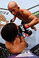 CHICAGO, IL - JANUARY 26:  Demetrious Johnson (Top) punches John Dodson (Bottom) during thier Flyweight Championship Bout part of UFC on FOX at United Center on January 26, 2013 in Chicago, Illinois.  (Photo by Al Bello/Zuffa LLC/Zuffa LLC Via Getty Images)