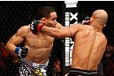 CHICAGO, IL - JANUARY 26:  John Dodson (L) punches Demetrious Johnson (R) during thier Flyweight Championship Bout part of UFC on FOX at United Center on January 26, 2013 in Chicago, Illinois.  (Photo by Josh Hedges/Zuffa LLC/Zuffa LLC Via Getty Images)