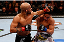 CHICAGO, IL - JANUARY 26:  Demetrious Johnson (L) punches John Dodson (R) during thier Flyweight Championship Bout part of UFC on FOX at United Center on January 26, 2013 in Chicago, Illinois.  (Photo by Josh Hedges/Zuffa LLC/Zuffa LLC Via Getty Images)