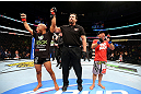 CHICAGO, IL - JANUARY 26:  Demetrious Johnson (L) celebrates defeating John Dodson (R) during thier Flyweight Championship Bout part of UFC on FOX at United Center on January 26, 2013 in Chicago, Illinois.  (Photo by Al Bello/Zuffa LLC/Zuffa LLC Via Getty Images)