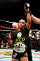 CHICAGO, IL - JANUARY 26:  Demetrious Johnson celebrates defeating John Dodson during thier Flyweight Championship Bout part of UFC on FOX at United Center on January 26, 2013 in Chicago, Illinois.  (Photo by Al Bello/Zuffa LLC/Zuffa LLC Via Getty Images)