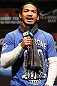 LAS VEGAS, NV - FEBRUARY 01:  UFC lightweight champion Benson Henderson interacts with fans during a Q&amp;A session before the UFC 156 weigh-in on February 1, 2013 at Mandalay Bay Events Center in Las Vegas, Nevada.  (Photo by Josh Hedges/Zuffa LLC/Zuffa LLC via Getty Images)