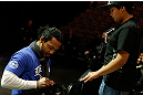 LAS VEGAS, NV - FEBRUARY 01:  UFC lightweight champion Benson Henderson signs an autograph for a young fan during a Q&amp;A session before the UFC 156 weigh-in on February 1, 2013 at Mandalay Bay Events Center in Las Vegas, Nevada.  (Photo by Josh Hedges/Zuffa LLC/Zuffa LLC via Getty Images)