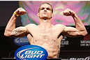 LAS VEGAS, NV - FEBRUARY 01:  Evan Dunham weighs in during the UFC 156 weigh-in on February 1, 2013 at Mandalay Bay Events Center in Las Vegas, Nevada.  (Photo by Josh Hedges/Zuffa LLC/Zuffa LLC via Getty Images)