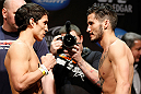 LAS VEGAS, NV - FEBRUARY 01:  (L-R) Opponents Joseph Benavidez and Ian McCall face off during the UFC 156 weigh-in on February 1, 2013 at Mandalay Bay Events Center in Las Vegas, Nevada.  (Photo by Josh Hedges/Zuffa LLC/Zuffa LLC via Getty Images)