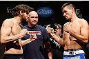 LAS VEGAS, NV - FEBRUARY 01:  (L-R) Opponents Jon Fitch and Demian Maia face off during the UFC 156 weigh-in on February 1, 2013 at Mandalay Bay Events Center in Las Vegas, Nevada.  (Photo by Josh Hedges/Zuffa LLC/Zuffa LLC via Getty Images)
