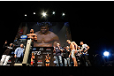 LAS VEGAS, NV - FEBRUARY 01:  Alistair Overeem weighs in as his opponent Antonio &quot;Bigfoot&quot; Silva looks on during the UFC 156 weigh-in on February 1, 2013 at Mandalay Bay Events Center in Las Vegas, Nevada.  (Photo by Josh Hedges/Zuffa LLC/Zuffa LLC via Getty Images)