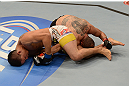 LAS VEGAS, NV - FEBRUARY 02:  (L-R) Dustin Kimura attempts to submit Chico Camus during their bantamweight fight at UFC 156 on February 2, 2013 at the Mandalay Bay Events Center in Las Vegas, Nevada.  (Photo by Donald Miralle/Zuffa LLC/Zuffa LLC via Getty Images) *** Local Caption *** Chico Camus; Dustin Kimura