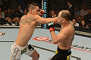 LAS VEGAS, NV - FEBRUARY 02:  (L-R) Dustin Kimura punches Chico Camus during their bantamweight fight at UFC 156 on February 2, 2013 at the Mandalay Bay Events Center in Las Vegas, Nevada.  (Photo by Donald Miralle/Zuffa LLC/Zuffa LLC via Getty Images) *** Local Caption *** Chico Camus; Dustin Kimura