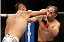 LAS VEGAS, NV - FEBRUARY 02:  (L-R) Dustin Kimura punches Chico Camus during their bantamweight fight at UFC 156 on February 2, 2013 at the Mandalay Bay Events Center in Las Vegas, Nevada.  (Photo by Josh Hedges/Zuffa LLC/Zuffa LLC via Getty Images) *** Local Caption *** Chico Camus; Dustin Kimura