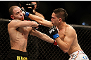 LAS VEGAS, NV - FEBRUARY 02:  (R-L) Dustin Kimura punches Chico Camus during their bantamweight fight at UFC 156 on February 2, 2013 at the Mandalay Bay Events Center in Las Vegas, Nevada.  (Photo by Josh Hedges/Zuffa LLC/Zuffa LLC via Getty Images) *** Local Caption *** Chico Camus; Dustin Kimura