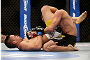 LAS VEGAS, NV - FEBRUARY 02:  Dustin Kimura (left) attempts to submit Chico Camus during their bantamweight fight at UFC 156 on February 2, 2013 at the Mandalay Bay Events Center in Las Vegas, Nevada.  (Photo by Josh Hedges/Zuffa LLC/Zuffa LLC via Getty Images) *** Local Caption *** Chico Camus; Dustin Kimura