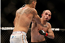 LAS VEGAS, NV - FEBRUARY 02:  (R-L) Chico Camus punches Dustin Kimura during their bantamweight fight at UFC 156 on February 2, 2013 at the Mandalay Bay Events Center in Las Vegas, Nevada.  (Photo by Josh Hedges/Zuffa LLC/Zuffa LLC via Getty Images) *** Local Caption *** Chico Camus; Dustin Kimura