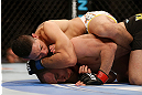 LAS VEGAS, NV - FEBRUARY 02:  Dustin Kimura (top) attempts to submit Chico Camus during their bantamweight fight at UFC 156 on February 2, 2013 at the Mandalay Bay Events Center in Las Vegas, Nevada.  (Photo by Josh Hedges/Zuffa LLC/Zuffa LLC via Getty Images) *** Local Caption *** Chico Camus; Dustin Kimura