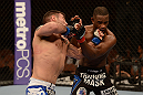 LAS VEGAS, NV - FEBRUARY 02:  (L-R) Isaac Vallie-Flagg punches Yves Edwards during their lightweight fight at UFC 156 on February 2, 2013 at the Mandalay Bay Events Center in Las Vegas, Nevada.  (Photo by Donald Miralle/Zuffa LLC/Zuffa LLC via Getty Images) *** Local Caption *** Yves Edwards; Isaac Vallie-Flagg