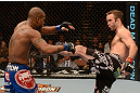 LAS VEGAS, NV - FEBRUARY 02:  (R-L) Jacob Volkmann kicks Bobby Green during their lightweight fight at UFC 156 on February 2, 2013 at the Mandalay Bay Events Center in Las Vegas, Nevada.  (Photo by Donald Miralle/Zuffa LLC/Zuffa LLC via Getty Images) *** Local Caption *** Jacob Volkmann; Bobby Green