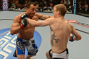 LAS VEGAS, NV - FEBRUARY 02:  (L-R) Gleison Tibau punches Evan Dunham during their lightweight fight at UFC 156 on February 2, 2013 at the Mandalay Bay Events Center in Las Vegas, Nevada.  (Photo by Donald Miralle/Zuffa LLC/Zuffa LLC via Getty Images) *** Local Caption *** Gleison Tibau; Evan Dunham