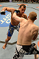 LAS VEGAS, NV - FEBRUARY 02:  Evan Dunham (black trunks) punches Gleison Tibau during their lightweight fight at UFC 156 on February 2, 2013 at the Mandalay Bay Events Center in Las Vegas, Nevada.  (Photo by Donald Miralle/Zuffa LLC/Zuffa LLC via Getty Images) *** Local Caption *** Gleison Tibau; Evan Dunham